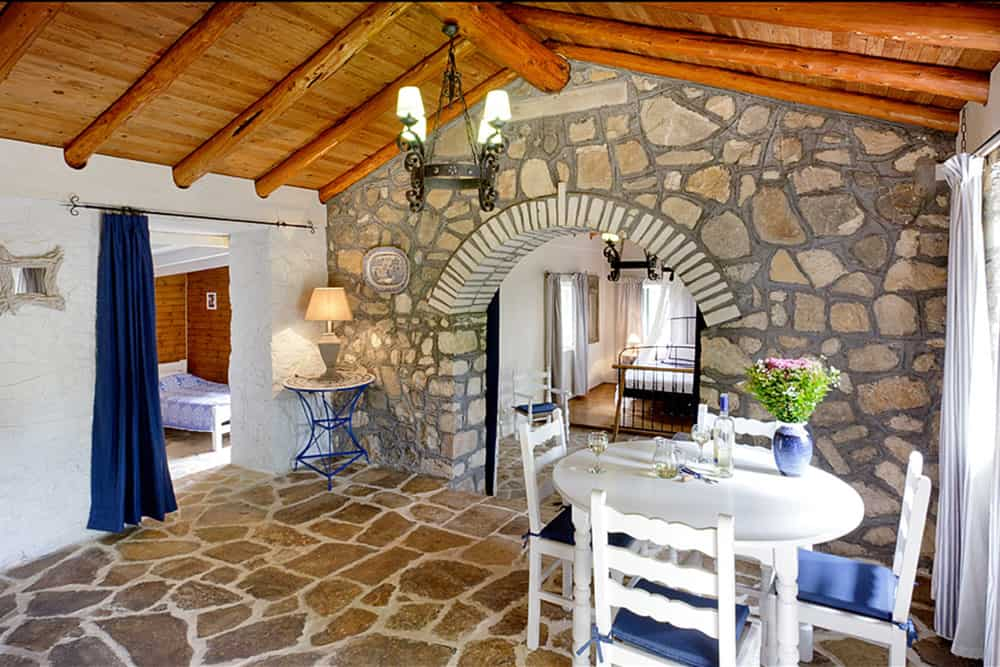 Kitchen Area And Separate Bedroom Stone House
